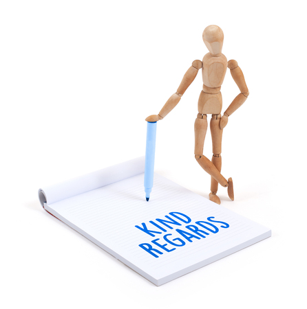 artists dummy: Wooden mannequin writing in a scrapbook - Kind regards Stock Photo