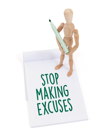 artists dummies: Wooden mannequin writing in a scrapbook - Stop making excuses Stock Photo