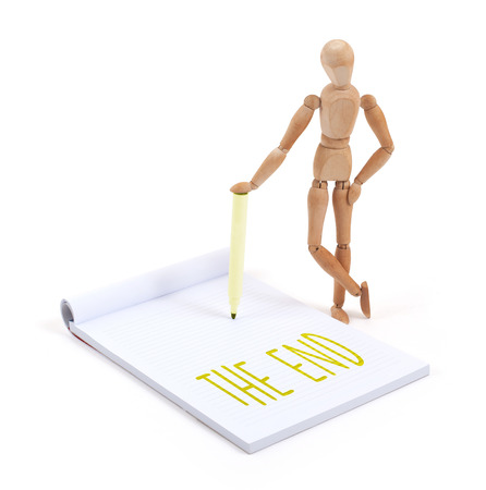 artists dummy: Wooden mannequin writing in a scrapbook - The end