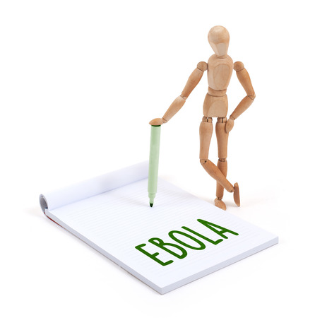 artists dummy: Wooden mannequin writing in a scrapbook - Ebola
