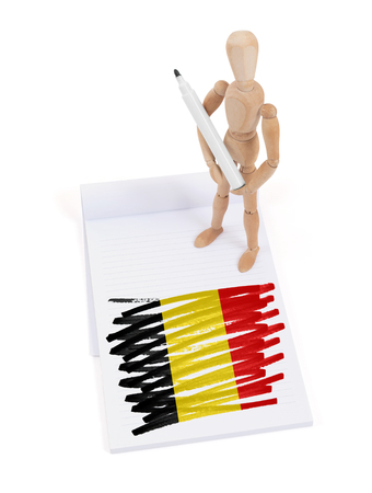 made in belgium: Wooden mannequin made a drawing of a flag - Belgium