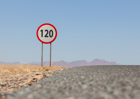 mph: Speed limit sign at a desert road in Namibia, speed limit of 120 kph or mph Stock Photo