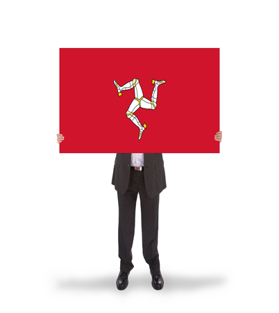 man holding card: Smiling businessman holding a big card, flag of Isle of Man, isolated on white
