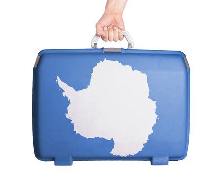 maleta: maleta usada plástico con manchas y arañazos, impreso con la bandera - la Antártida