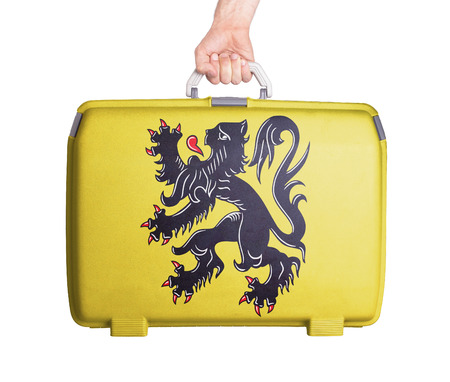 scratches: Used plastic suitcase with stains and scratches, printed with flag - Flanders