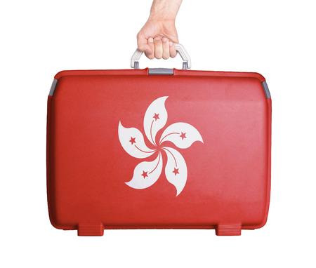 scratches: Used plastic suitcase with stains and scratches, printed with flag - Hong Kong