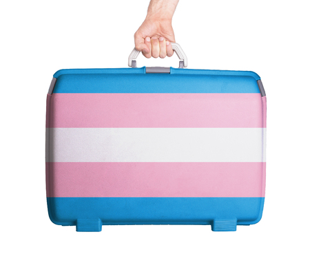 trans gender: Used plastic suitcase with stains and scratches, printed with flag - Trans Pride Stock Photo