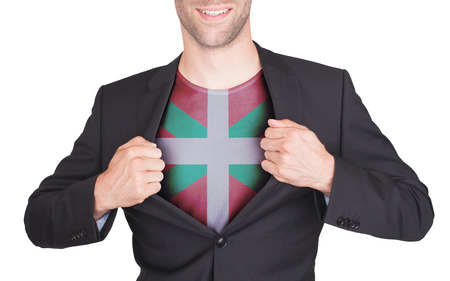 the basque country: Businessman opening suit to reveal shirt with flag, Basque Country