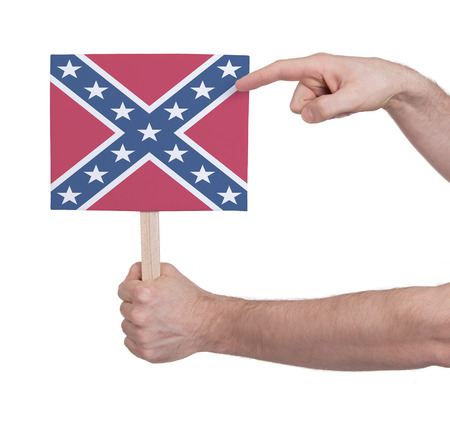 confederacy: Hand holding small card, isolated on white - Flag of the Confederacy