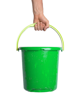 drudgery: Human hand holding empty plastic pail, isolated on white