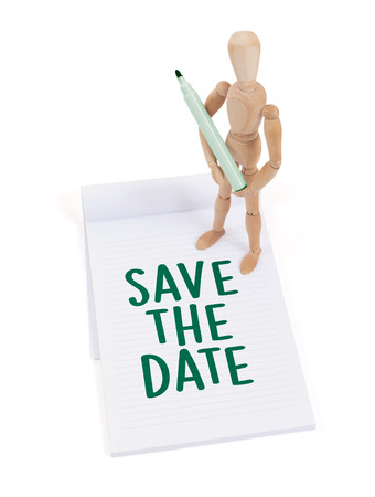 artists mannequin: Wooden mannequin writing in a scrapbook - Save the date