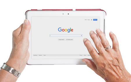 adwords: HEERENVEEN, NETHERLANDS - JUNE 6, 2015: Google is an American multinational corporation specializing in Internet-related services and products. Most of its profits are derived from AdWords. Editorial