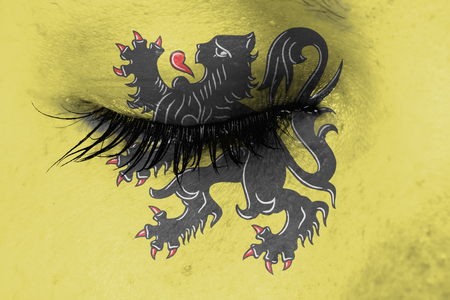 flanders: Women eye, close-up, tear, flag of Flanders Stock Photo