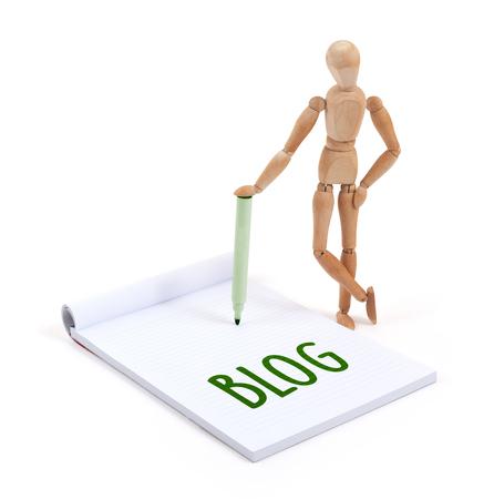 artists dummy: Wooden mannequin writing in a scrapbook - Blog