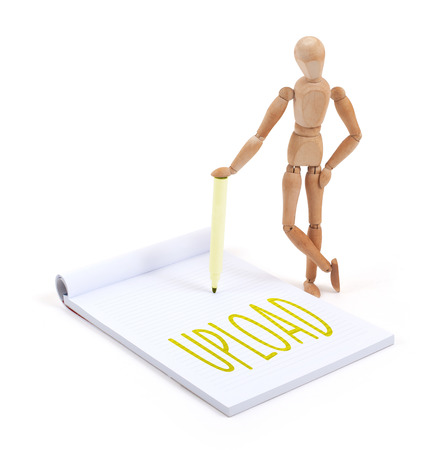 artists dummies: Wooden mannequin writing in a scrapbook - Upload