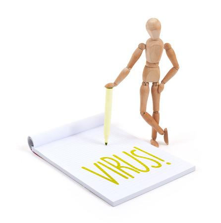 artists dummy: Wooden mannequin writing in a scrapbook - Virus