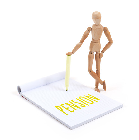 artists dummy: Wooden mannequin writing in a scrapbook - Pension Stock Photo