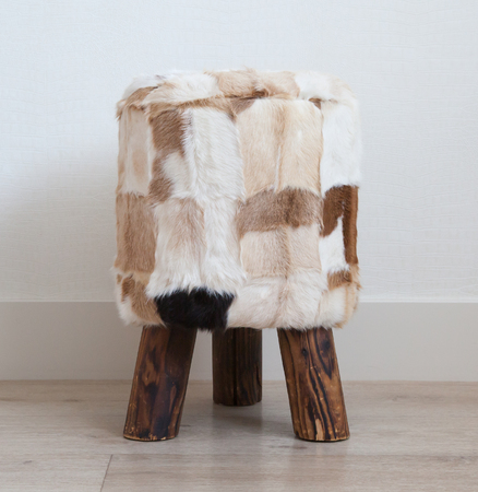 cowhide: Small stool made of cowhide and wood