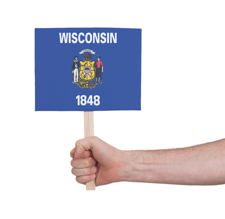 wisconsin flag: Hand holding small card, isolated on white - Flag of Wisconsin