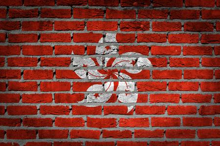 bulwark: Dark brick wall texture - flag painted on wall - Hong Kong Stock Photo