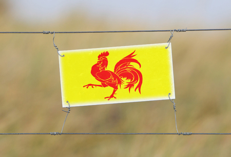 old sign: Border fence - Old plastic sign with a flag - Wallonia
