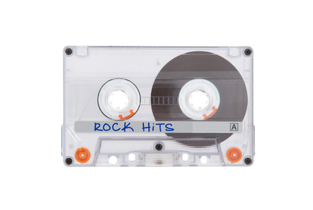 hits: Vintage audio cassette tape, isolated on white background, rock hits Stock Photo