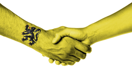 flanders: Man and woman shaking hands, wrapped in flag pattern, Flanders Stock Photo
