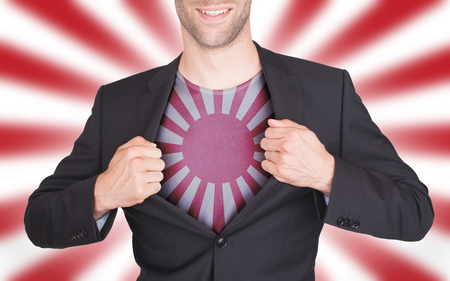 reveal: Businessman opening suit to reveal shirt with flag, Japan Stock Photo