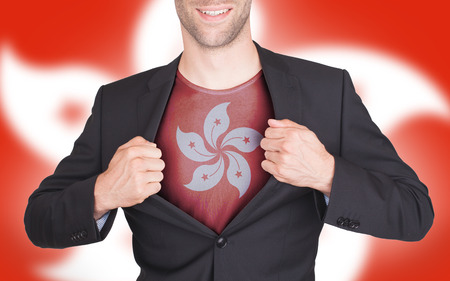 reveal: Businessman opening suit to reveal shirt with flag, Hong Kong Stock Photo