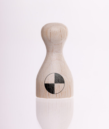 boardgames: Wooden pawn with a painting of a flag, Crash test dummy Stock Photo