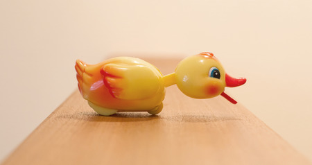 yellow duck: Plastic yellow duck, childrens toy isolated, selective focus Stock Photo