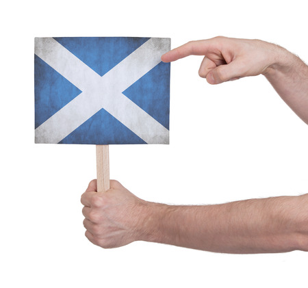 scotish: Hand holding small card, isolated on white - Flag of Scotland