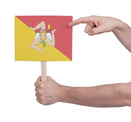 Hand holding small card, isolated on white - Flag of Sicily