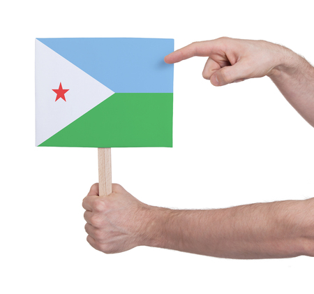 djibouti: Hand holding small card, isolated on white - Flag of Djibouti Stock Photo