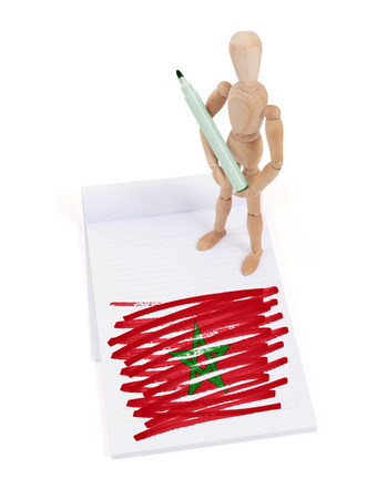 made in morocco: Wooden mannequin made a drawing of a flag - Morocco