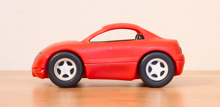 limbo: Clear colored small car toy, selective focus Stock Photo