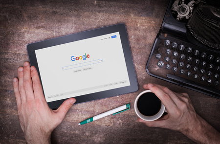 adwords: HEERENVEEN, NETHERLANDS - JUNE 6, 2015: Google is an American multinational corporation specializing in Internet-related services and products. Most of its profits are derived from AdWords. Stock Photo