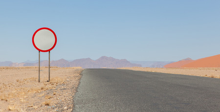 kph: Speed limit sign at a desert road in Namibia