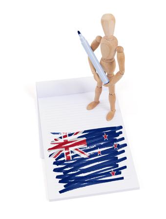 bandera de nueva zelanda: Maniqu� de madera que hizo un dibujo de una bandera - Nueva Zelanda