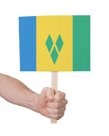 grenadines: Hand holding small card, isolated on white - Flag of Saint Vincent and the Grenadines Stock Photo
