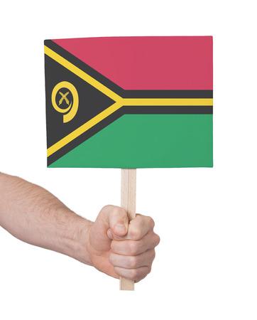 vanuatu: Hand holding small card, isolated on white - Flag of Vanuatu