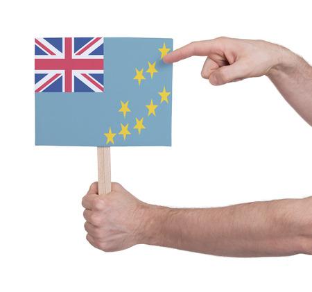 tuvalu: Hand holding small card, isolated on white - Flag of Tuvalu Stock Photo
