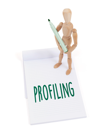 profiling: Wooden mannequin writing in a scrapbook - Profiling