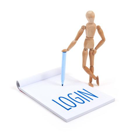 artists dummy: Wooden mannequin writing in a scrapbook - Login