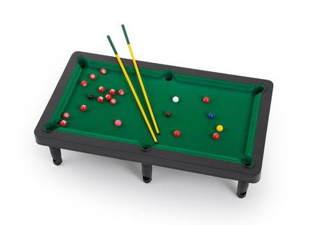 pool: Miniature billiard table on a white background