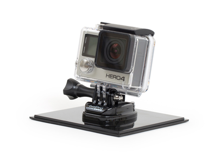 cam gear: Amsterdam, the Netherlands - June 30, 2015: GoPro Hero 4 Black Edition isolated on white background, GoPro is a brand of high-definition personal cameras, often used in extreme action video photography.