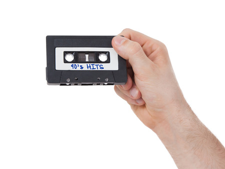 90s: Vintage audio cassette tape, isolated on white background, 90s hits Stock Photo