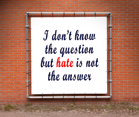 i dont know: Large banner with inspirational quote on a brick wall - I dont know the question but hate is not the answer