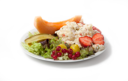 ensalada rusa: Snack time - View of Russian salad on a white plate, isolated