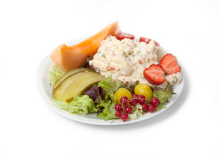 snack time: Snack time - View of Russian salad on a white plate, isolated